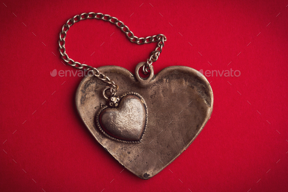 two vintage heart shaped jewels on top of each other - Stock Photo - Images