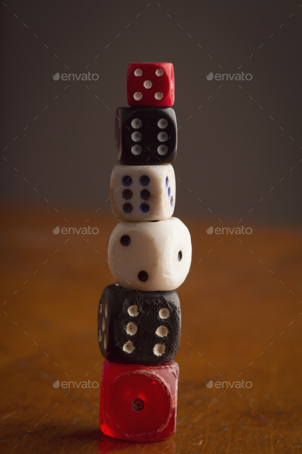 different size and color rolling dices on wooden background - Stock Photo - Images