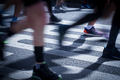 closeup on marathon runners legs and feet with motion blur - PhotoDune Item for Sale