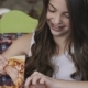 Portrait of Pretty Young Girl Eating Pizza with Delight in Cafe - VideoHive Item for Sale