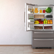 Open fridge  refrigerator full of food in the empty kitchen inte - PhotoDune Item for Sale