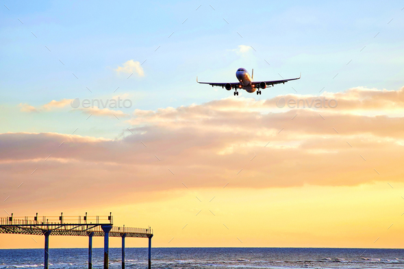 airplain at sunset - Stock Photo - Images
