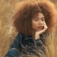 Black Mixed Race Woman with Big Afro Curly Hair in Lawn Field with High Dry Autumn Hay Grass and - VideoHive Item for Sale