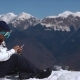 Snowboarder Using Phone in the Mountains - VideoHive Item for Sale
