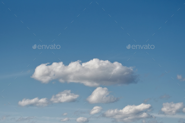 Clear blue sky with plain white cloud with space for text background. - Stock Photo - Images