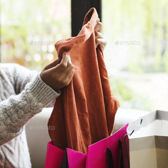 Woman unpacking a shopping bag - Stock Photo - Images
