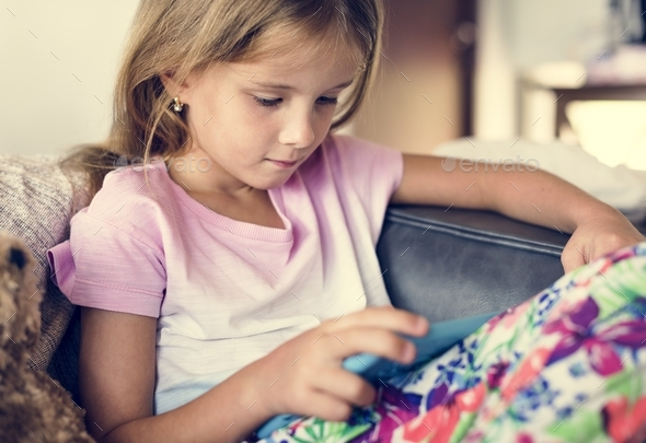 Young girl is using digital tablet - Stock Photo - Images