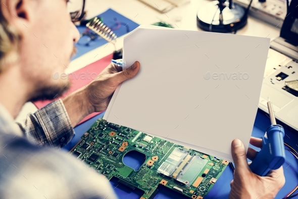 Technicians working holding blank paper - Stock Photo - Images