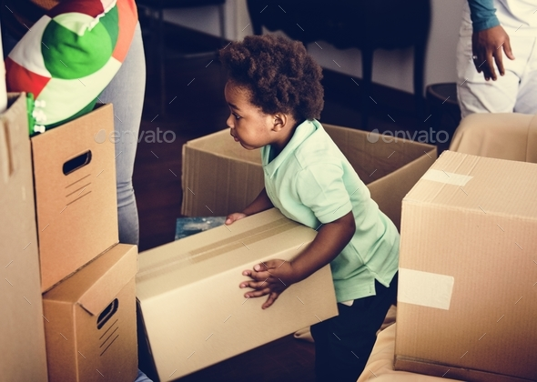 Black family moving in to their new house - Stock Photo - Images