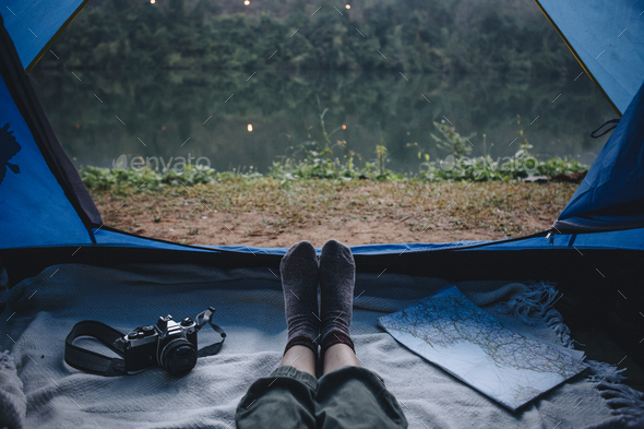 People camping by the river - Stock Photo - Images