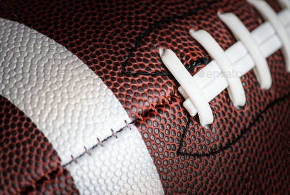 Macro shot of American football ball background - Stock Photo - Images