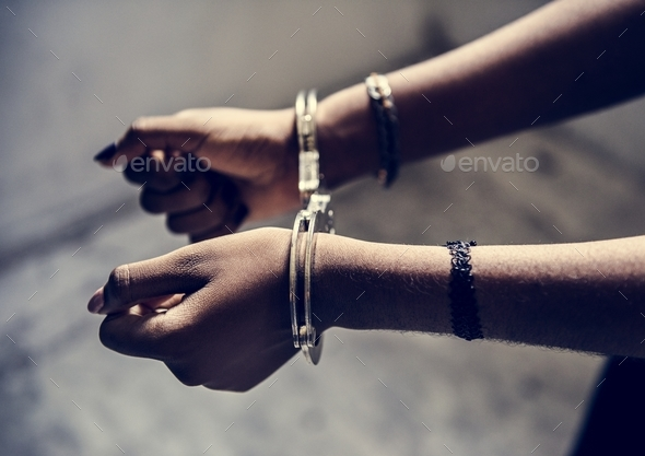 Closeup of arrested hands with handcuffs - Stock Photo - Images