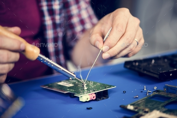 Closeup of tin soldering with electronics circuit board - Stock Photo - Images