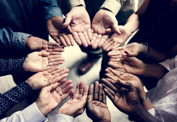 Group of diverse hands in a circle - Stock Photo - Images
