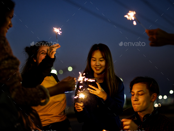 Group of school friends happiness and playing firework - Stock Photo - Images