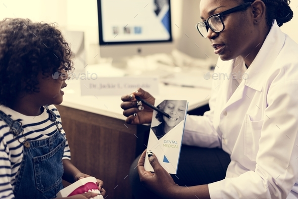 African kid having a conversation with a doctor - Stock Photo - Images