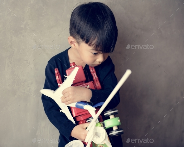 Young asian boy innocence adorable playing toy - Stock Photo - Images