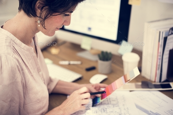 Businesswoman working in office - Stock Photo - Images