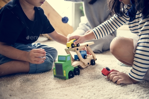 Brother and sister playing together - Stock Photo - Images