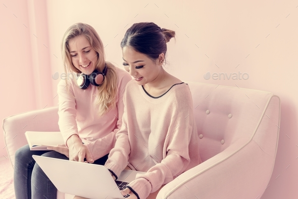 Women friends sitting in living room together - Stock Photo - Images