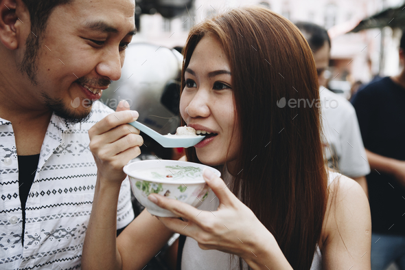 Woman having asian dessert outdoors - Stock Photo - Images