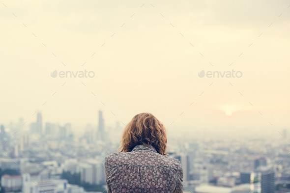 Blond woman at a rooftop - Stock Photo - Images