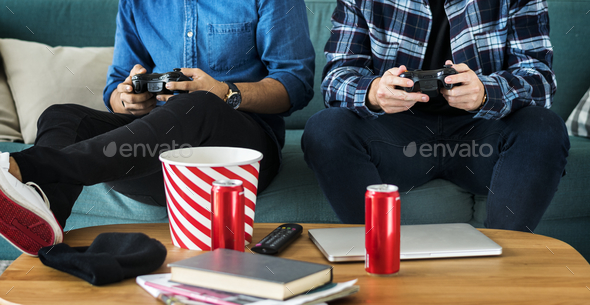 Men playing video game on a sofa leisure and teamwork concept - Stock Photo - Images