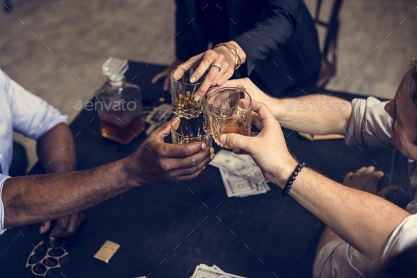 Hand toasting an alcohol together - Stock Photo - Images