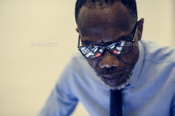 African ethnicity businessman working - Stock Photo - Images