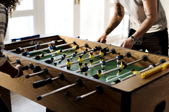 People playing table football - Stock Photo - Images