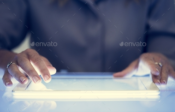 Hands holding using digital tablet on a cyber space table - Stock Photo - Images