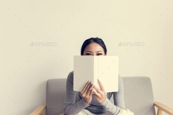 Asian woman reading lifestyle at home - Stock Photo - Images