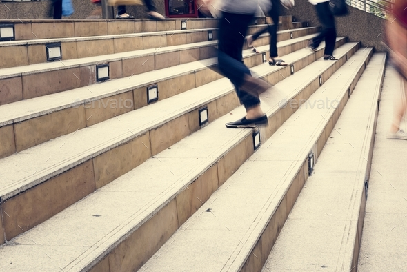 Crowd of people in blurred motion walking up and down the stair - Stock Photo - Images
