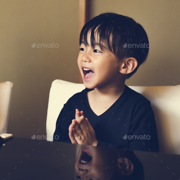 Young asian boy innocence adorable laughing - Stock Photo - Images