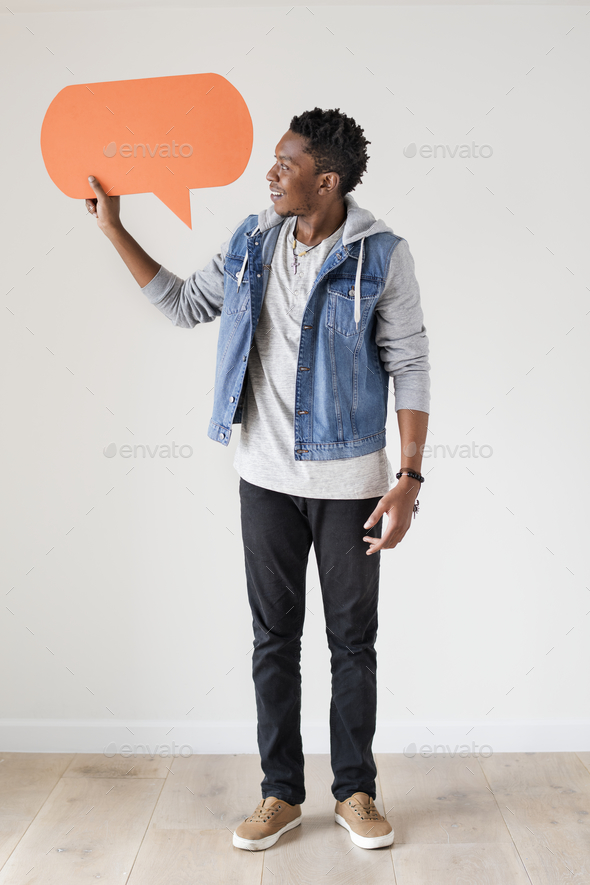 Happy African American man holding copyspace speech bubble - Stock Photo - Images