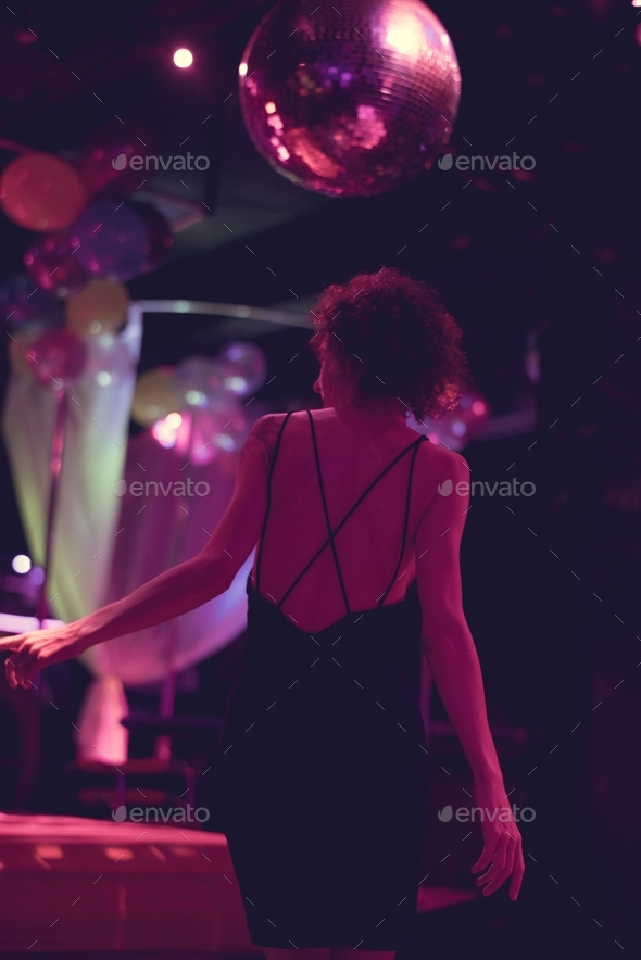 Woman on the dance floor of a club - Stock Photo - Images