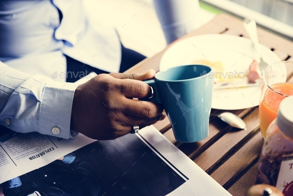 Closeup of hand holding coffee cup - Stock Photo - Images