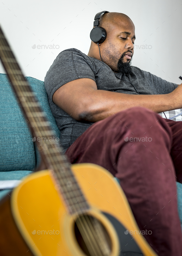 Man composing a new song - Stock Photo - Images