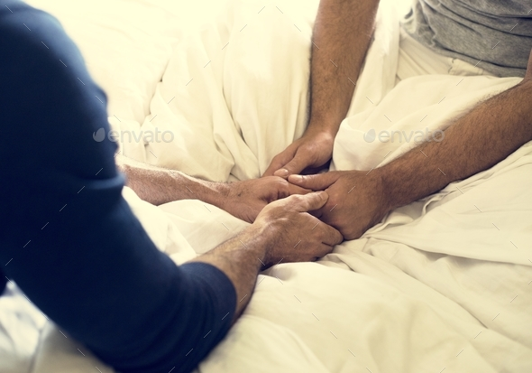 Closeup of a couple holding hands - Stock Photo - Images