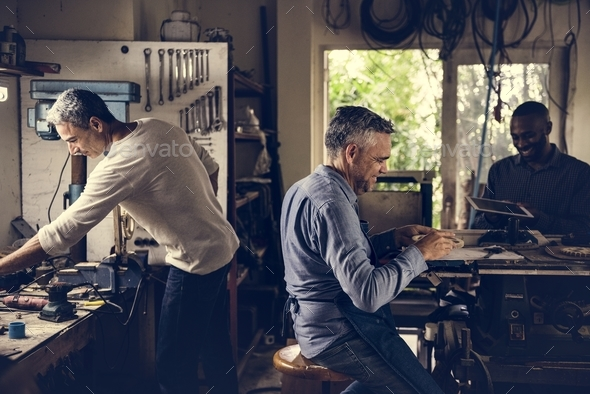 Men working in a workshop - Stock Photo - Images