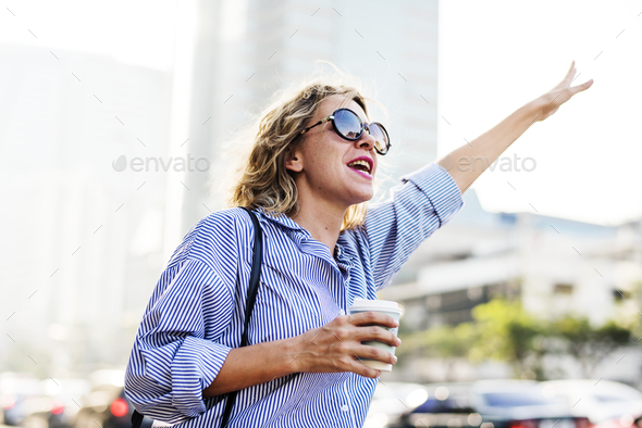 Woman wave for a cab - Stock Photo - Images