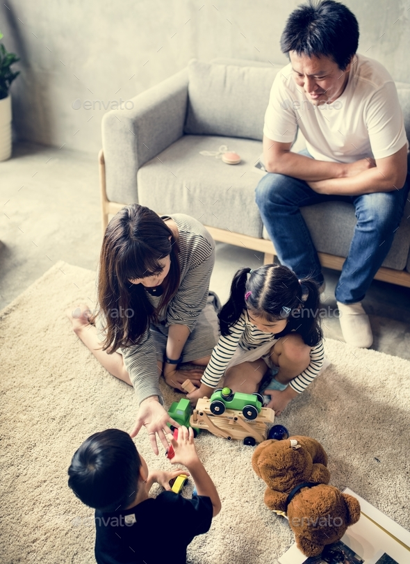 Family spenting time together at home - Stock Photo - Images