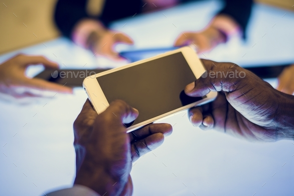 Group of hands holding using smartphone - Stock Photo - Images
