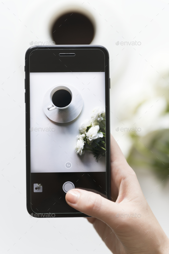 Woman taking photo with mobile phone - Stock Photo - Images