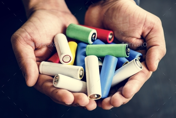 Hands holding various alkaline battery - Stock Photo - Images