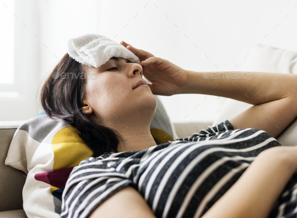 Woman with a cold and high fever - Stock Photo - Images