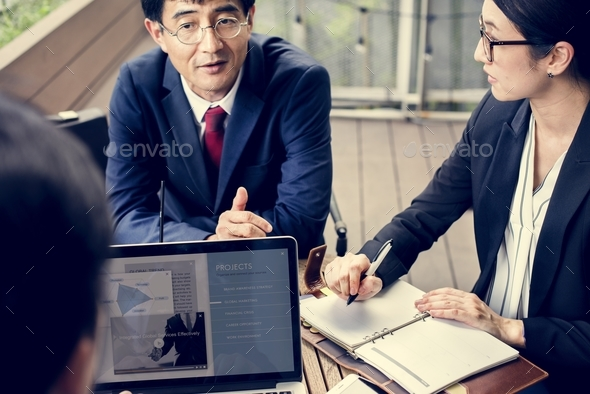 Japanese business people discussing - Stock Photo - Images