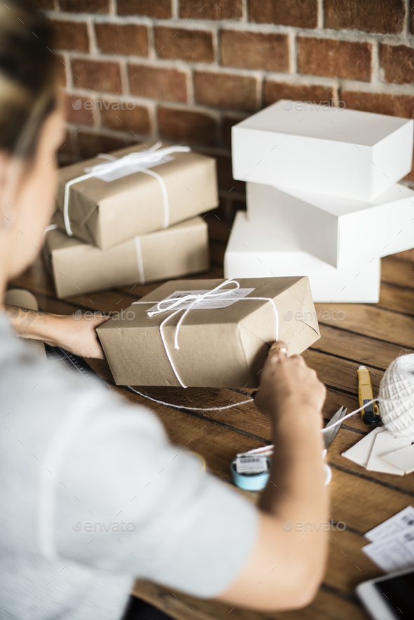 Woman packing parcels - Stock Photo - Images