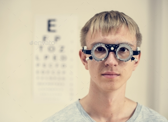Young man is having sight testing - Stock Photo - Images