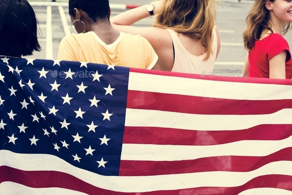 Rear view of group of diverse women group with American flag - Stock Photo - Images